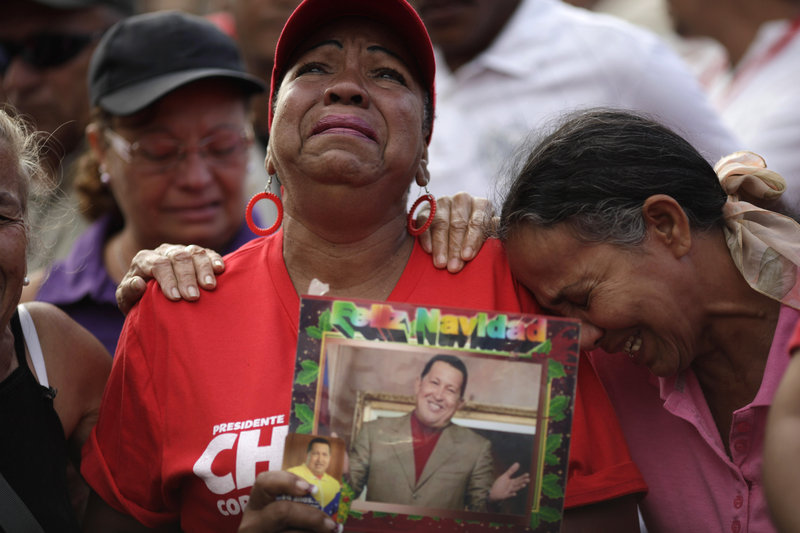 Supporters of Venezuela's late President Hugo Chavez mourn Wednesday outside the military hospital where Chavez died of cancer at age 58 Tuesday in Caracas. World leaders will attend his elaborate funeral Friday.