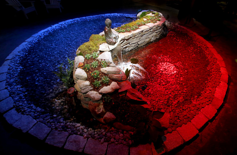 "A yin-yang water garden created by Robins Nest Aquatics is one of the many displays for visitors during the opening night of the ""Timeless Gardens"" Portland Flower Show at the Portland Company Complex in Portland on March 6, 2013."