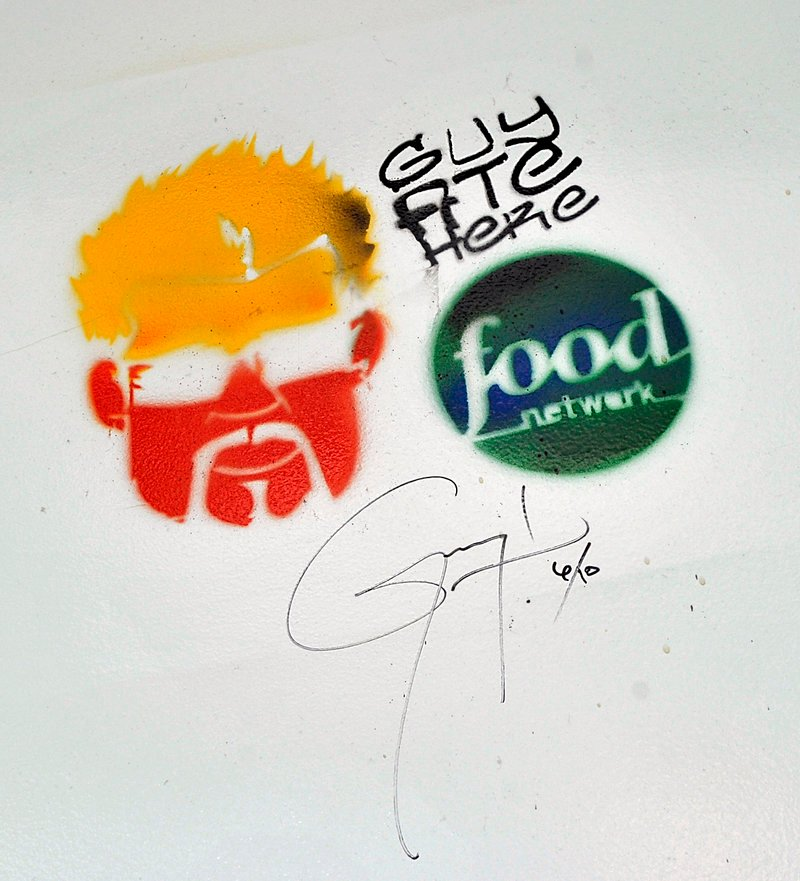 "Guy Fieri left his mark when his Food Network show ""Diners, Drive-Ins and Dives"" visited the old Porthole in 2011. New owner Ken Macgowan said he plans to preserve the image in the restaurant's newly renovated space."