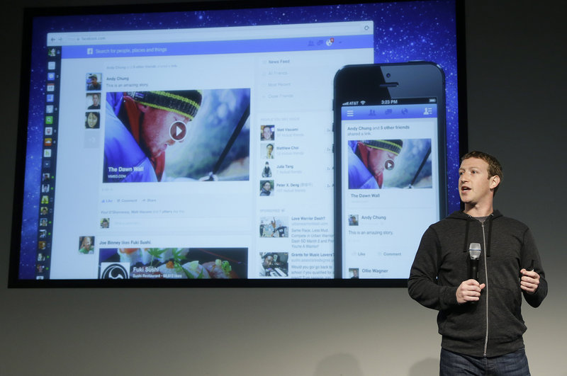 Facebook CEO Mark Zuckerberg unveils a new look for the company's News Feed in Menlo Park, Calif., on Thursday.