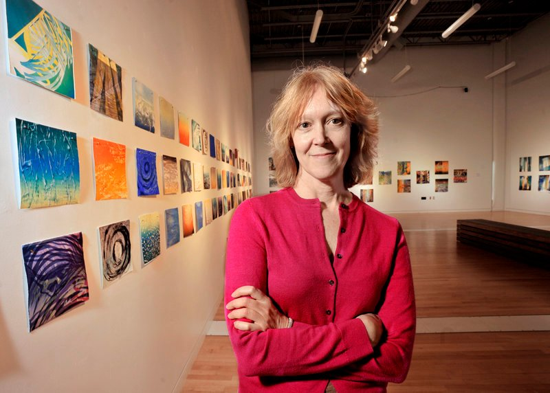 Emery Center director Jayne Decker in the visual arts gallery known as the Flex Space, which is currently showing works by Ellen Roberts and Karen Adrienne.