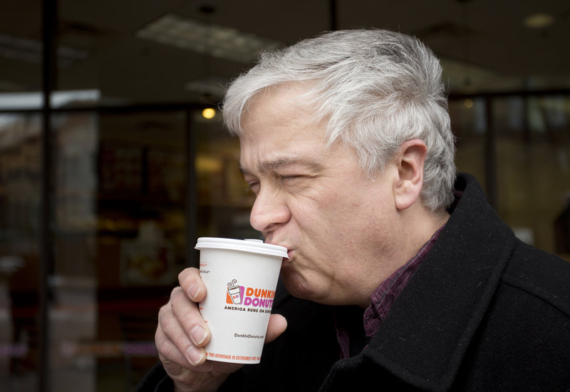 Ernie Mills of Old Orchard Beach sips coffee from his paper Dunkin' Donuts cup Friday. Mills said he prefers paper over Styrofoam because of the feel of the cup.