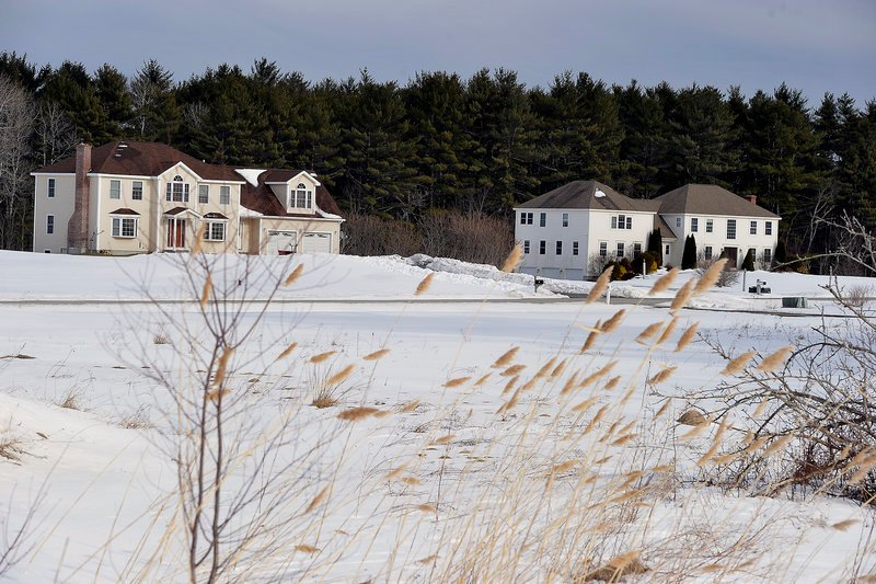 "High-end residential developments like this one abut the Comstock family farm. The easement deal ""is a great opportunity,"" says Chris Comstock. ""The farms are disappearing."""