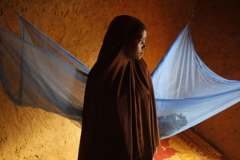 Zali Idy, 12, seen in her bedroom in the remote village of Hawkantaki, Niger, was married in 2011. In Niger, 75 percent of the girls under 18 are married – the highest rate in the world. Experts say that forced marriage for young girls leads to higher mortality rates, fewer girls attending school, and abuse within the marriage.