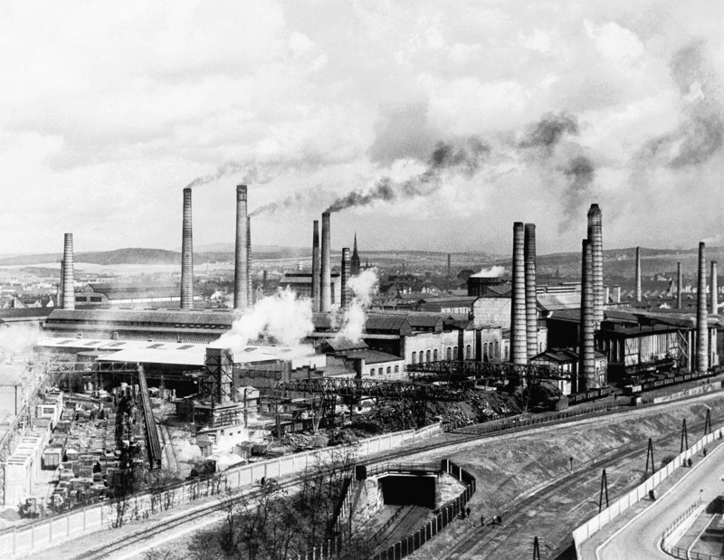Smoke rises from Skoda's main foundry in Pilsen, Czechoslovakia, in 1938. A new study looks at 11,000 years of temperatures.