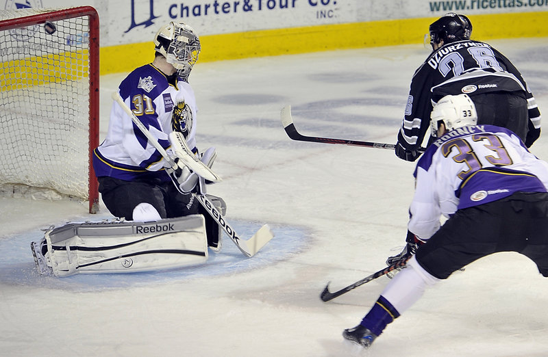 Darian Dziurzynski flips the puck over the shoulder of Manchester Monarchs goalie Martin Jones and into the top corner of the net for a first-period goal that gave the Pirates a 2-0 lead. Portland led 3-0 after one period but lost 4-3 in overtime.