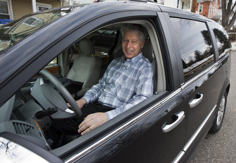 Jim Casso, 60, sits in the black van that he uses for his job, in front of his Meriden, Conn., home. Casso's job is picking up the deceased whose bodies are being donated to science for Quinnipiac University's medical school.
