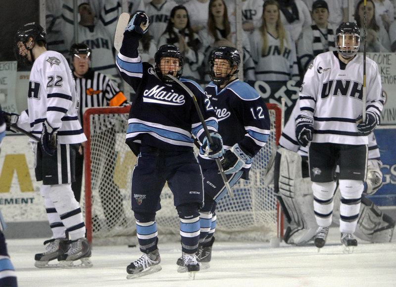 Adam Shemansky celebrates his goal in the second period Saturday that helped Maine earn a 4-4 tie at New Hampshire in its regular-season finale.