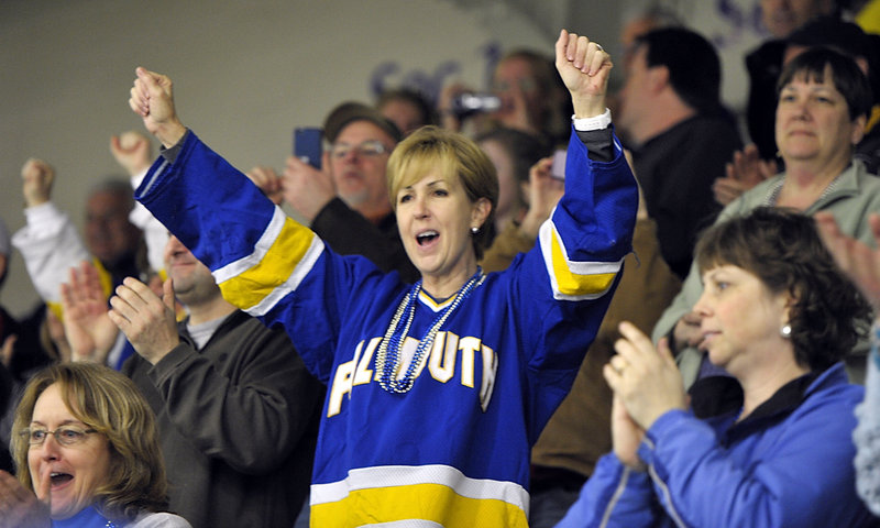 Doris Samaras, mother of Falmouth senior forward Kris Samaras, cheers on the Yachtsmen during Saturday's Class A state championship game.