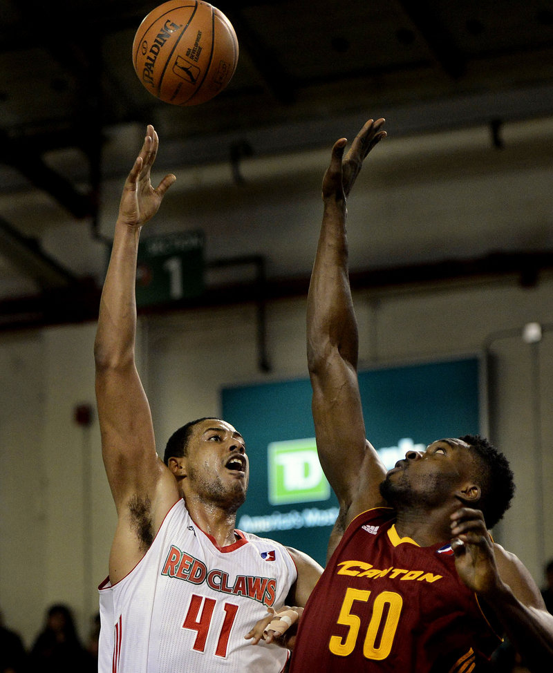 Red Claws center Fab Melo puts up a shot over Michael Eric of the Canton Charge during Sunday's D-League game at the Expo. Canton won, 108-83.