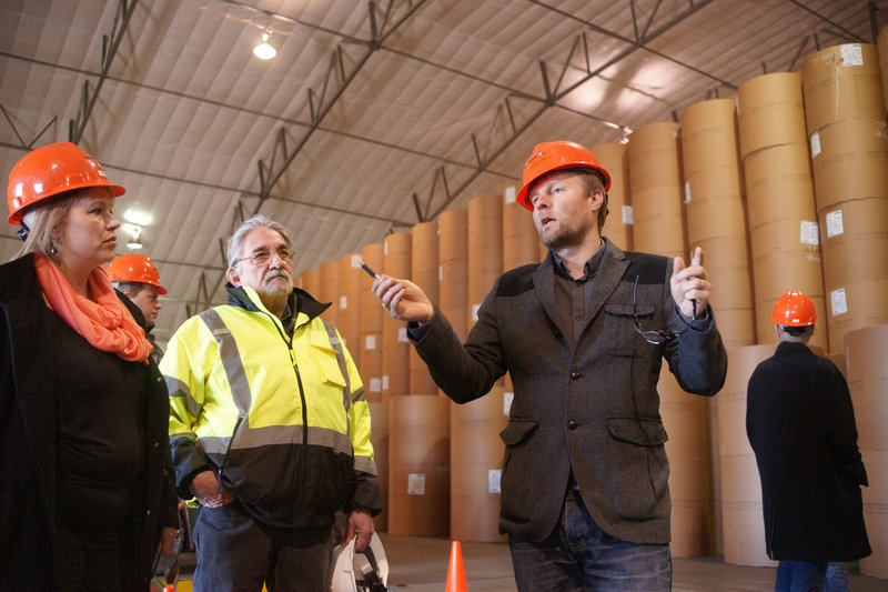 Larus Isfeld, a senior manager at Eimskip, talks about storing bulk freight, such as water from Iceland, in Sprague's climate-controlled warehouse at Merrill's Marine Terminal in Portland. Listening are Joanne Gibbons, Eimskip's freight forwarding manager in St. John's, Newfoundland, and Arnand Demers, director of forest products/materials handling for Sprague.