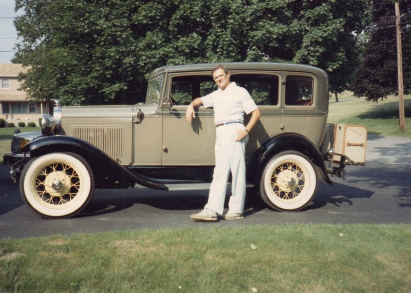 """Aime Alfred Levecque stands with """"Daisy,"""" his 1931 Model A, around 1990. He loved to take his grandchildren for rides in it."""