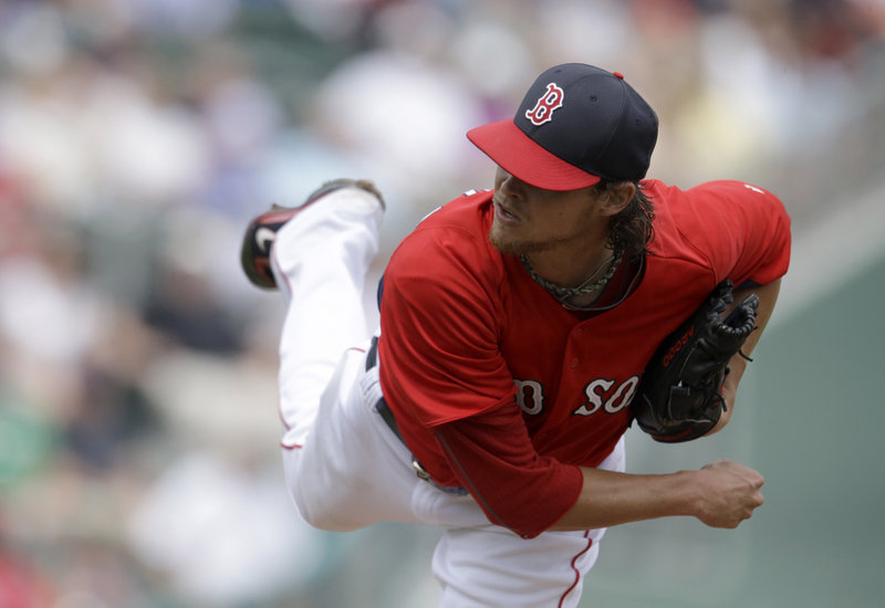 """Clay Buchholz pitches on his way to a win against the Toronto Blue Jays Tuesday. """"Better tempo once again, consistent with his last outing,"""" Red Sox Manager John Farrell said."""