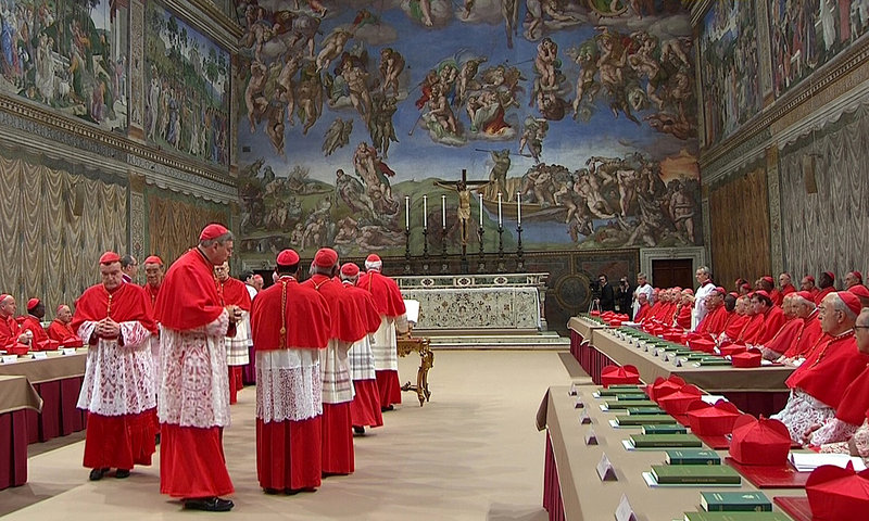 Cardinals file into the Sistine Chapel in the Vatican on Tuesday to begin the conclave to elect a successor to Pope Benedict. Michelangelo's frescoes soar above them as the 115 cardinals cast their ballots.