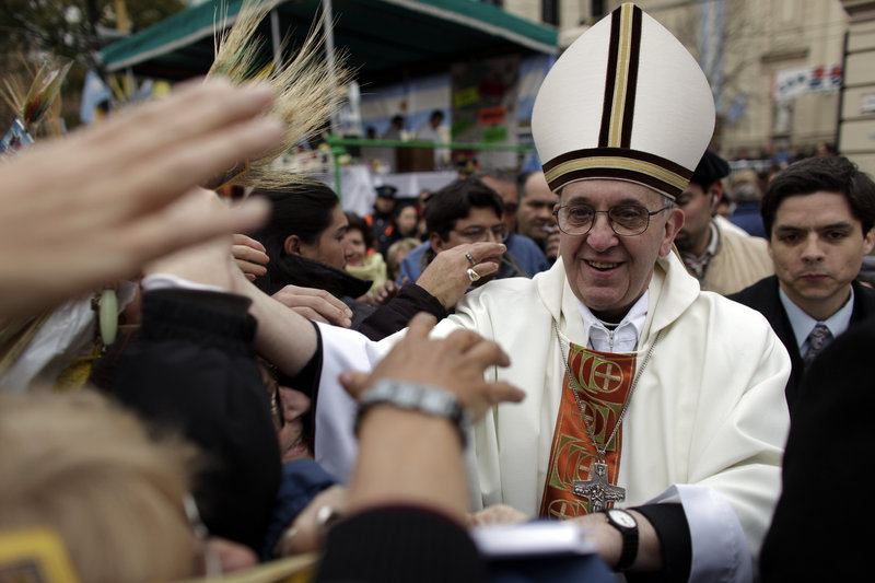 Then-Cardinal Jorge Bergoglio, now Pope Francis, greets crowds outside San Cayetano church in Buenos Aires in 2009. The new pope is a staunch conservative and devout Jesuit.