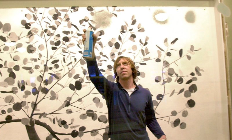 In this January 2005 file photo, artist Joe Kievitt does some touch up work on his large artwork hanging at Kennebunk Elementary School. Kievitt is among the artists chosen for the 2013 Portland Museum of Art Biennial.
