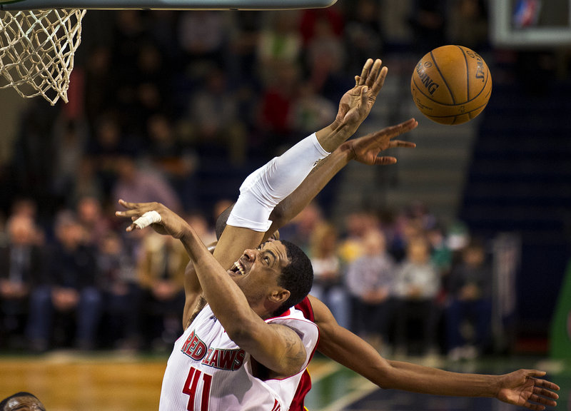 Fab Melo has his attempted slam-dunk knocked away by Fort Wayne's Brandon Wallace during Thursday's 105-90 loss at the Expo Center that leaves the Red Claws 1 1⁄2 games out of a playoff berth with just eight games left in the season.