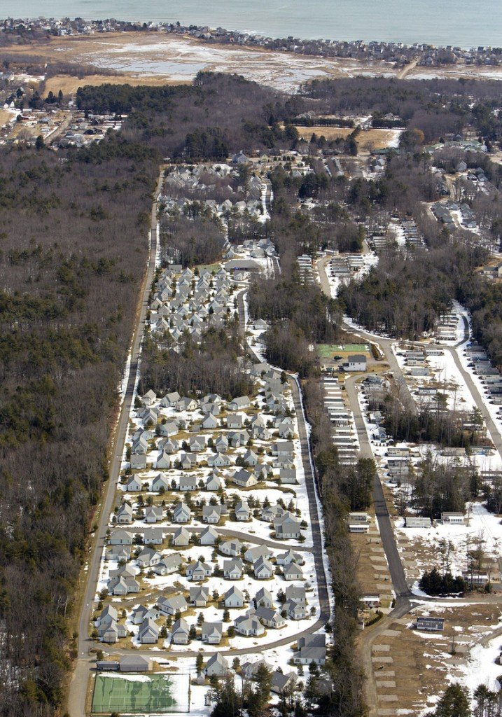 The Cottages at Summer Village are among the large lodging developments that pose a dilemma for the town of Wells, bringing in needed property tax revenue but stressing local services and adding to traffic congestion on Route 1.
