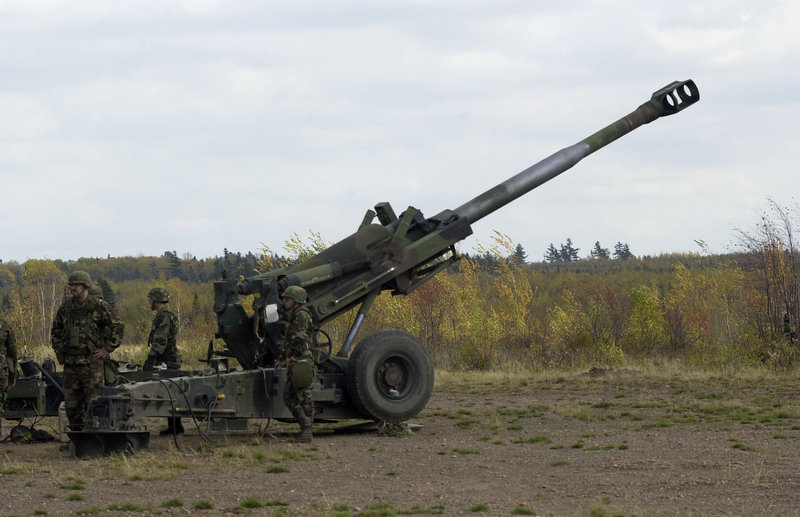 Maine Army National Guardsmen of Alpha Battery of the 1st Battalion, 152nd Field Artillery, load a round into a howitzer during training. Military veterans are concerned about exposure to defoliants and herbicides at the site.