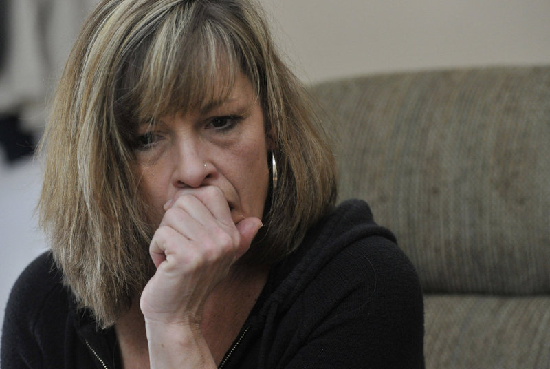"Laura Schlosser watches a video last week of the 2012 incident involving her son, inmate Paul Schlosser, and Capt. Shawn Welch at the Maine Correctional Center in Windham. ""As a mother, it makes me want to throw up,"" she said."