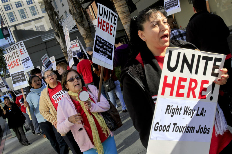 "Hotel workers protest outside a Los Angeles hotel in 2011. Labor organizers who have made little headway using traditional efforts to gain pay increases are finding success with ballot measures that call for a ""living wage."""