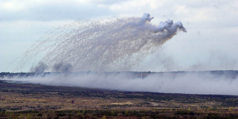 Smoke hovers over a field where artillery shells just hit at Canadian Forces Base Gagetown in New Brunswick, Canada, in October 2001.