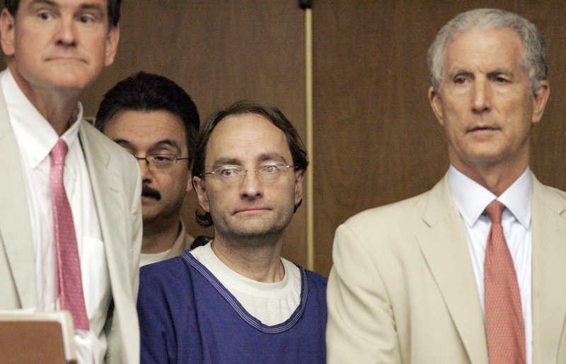Attorneys Bradford Bailey, left, and Jeffrey Denner, right, stand with Christian Karl Gerhartsreiter in court on July 8, 2011, in Alhambra, Calif. Gerhartsreiter, who masqueraded as a member of the famous Rockefeller family, faces charges that he murdered his landlord more than a quarter-century ago.