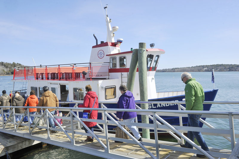 Chebeague Island-bound passengers file aboard the ferry Islander from the pier on Cousins Island. After an informal start, the Chebeague Transportation Co. formed in 1971.