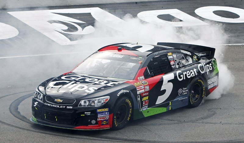 Kasey Kahne smokes 'em after his win over Kyle Busch at the Bristol Motor Speedway on Sunday – the second victory for the Hendrick team this year.