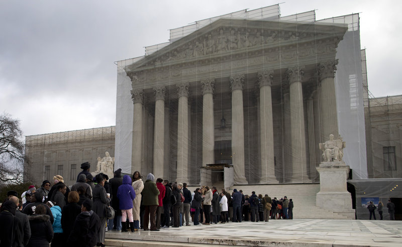 People wait in line outside the Supreme Court. In many states, taxpayer-funded public defenders face crushing caseloads, the quality of legal representation varies from county to county, and people stand before judges having seen a lawyer only briefly, if at all.