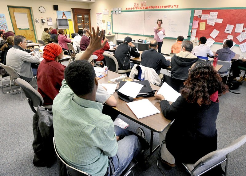 Immigrants attend English classes at West School in Portland in 2012. Accepting federal Medicaid funds would not only allow access to health care but also create jobs, addressing a need in the immigrant community, an advocate says.
