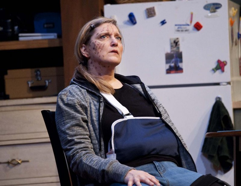 """Janet Mitchko as photojournalist Sarah Goodwin in """"Time Stands Still."""" The Public Theatre production concludes its run with shows Thursday through Sunday in Lewiston."""