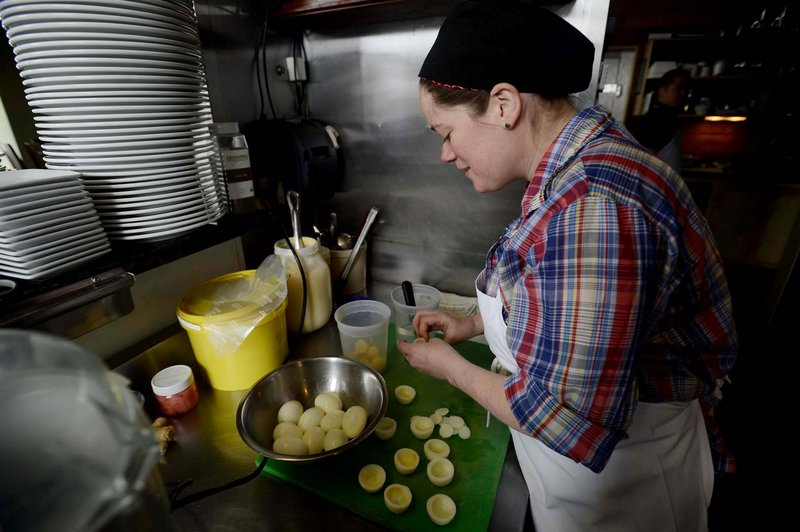 Skye Bonney works away at a batch of her high-end deviled eggs in the kitchen at The Black Birch in Kittery.