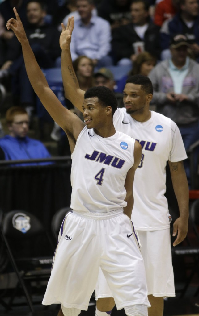 Charles Cooke, front, and Rayshawn Goins of James Madison celebrate after defeating LIU Brooklyn 68-55 in a First Four game in the NCAA tourney Wednesday night in Dayton, Ohio.