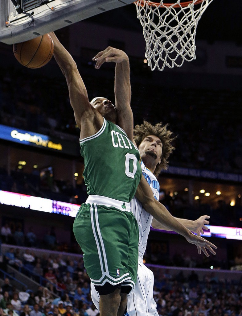 Avery Bradley of the Celts gets fouled by New Orleans' Robin Lopez in Wednesday's game at New Orleans. The Hornets won, 87-86.