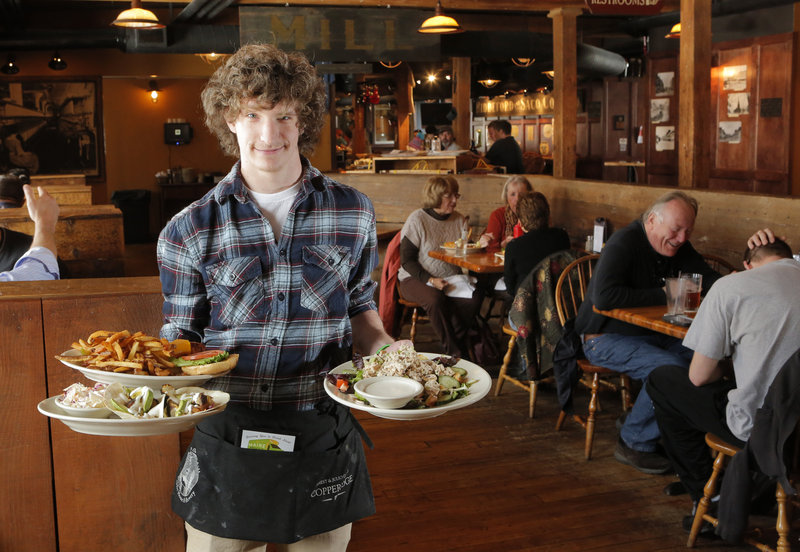 Spencer Lagerstrom delivers the Factory Island Fishwich, Fish Tacos and Chicken Salad at the Run of the Mill in Saco.