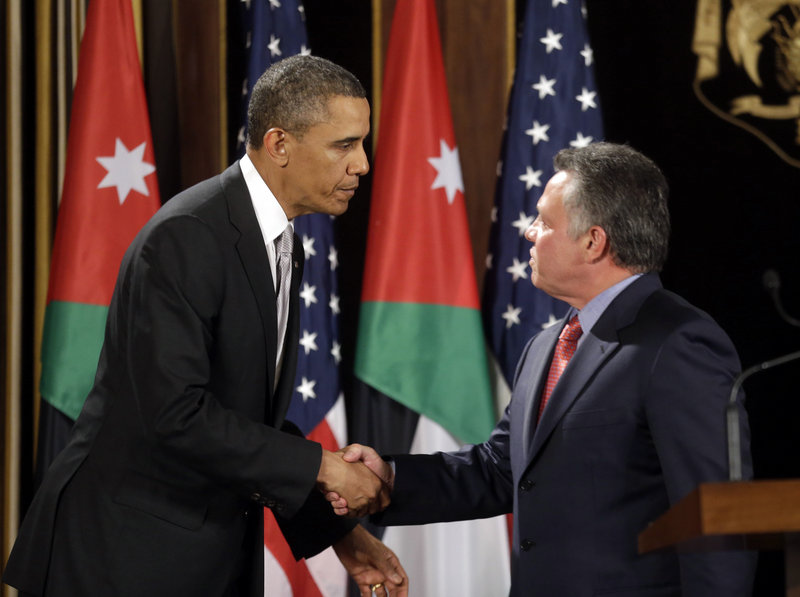 "President Barack Obama and Jordan's King Abdullah II shake hands in Amman, Jordan, on Friday. Obama said he is concerned Syria could become ""an enclave for extremism."""