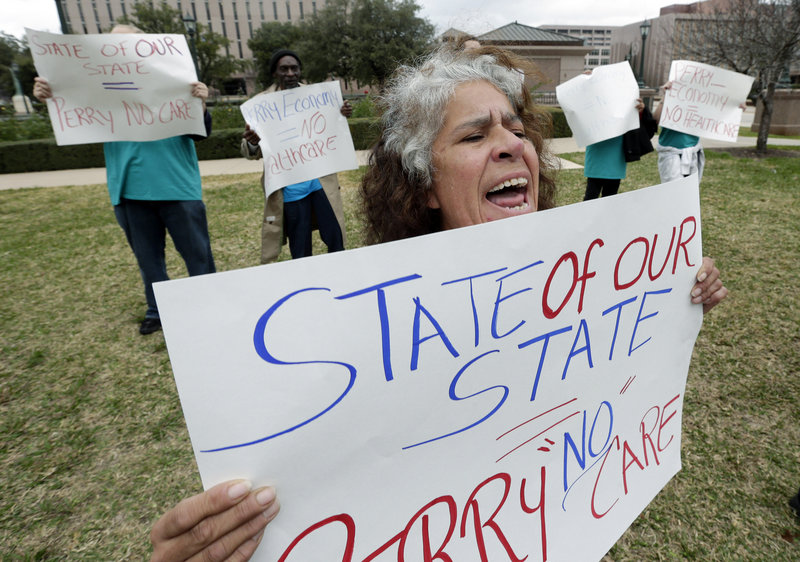 Maria Webster joins others protesting against Texas Gov. Rick Perry's stance on health care outside the state capitol in Austin, Texas, in January. Despite the state having the highest percentage of uninsured, Perry is not promoting federal insurance exchanges.