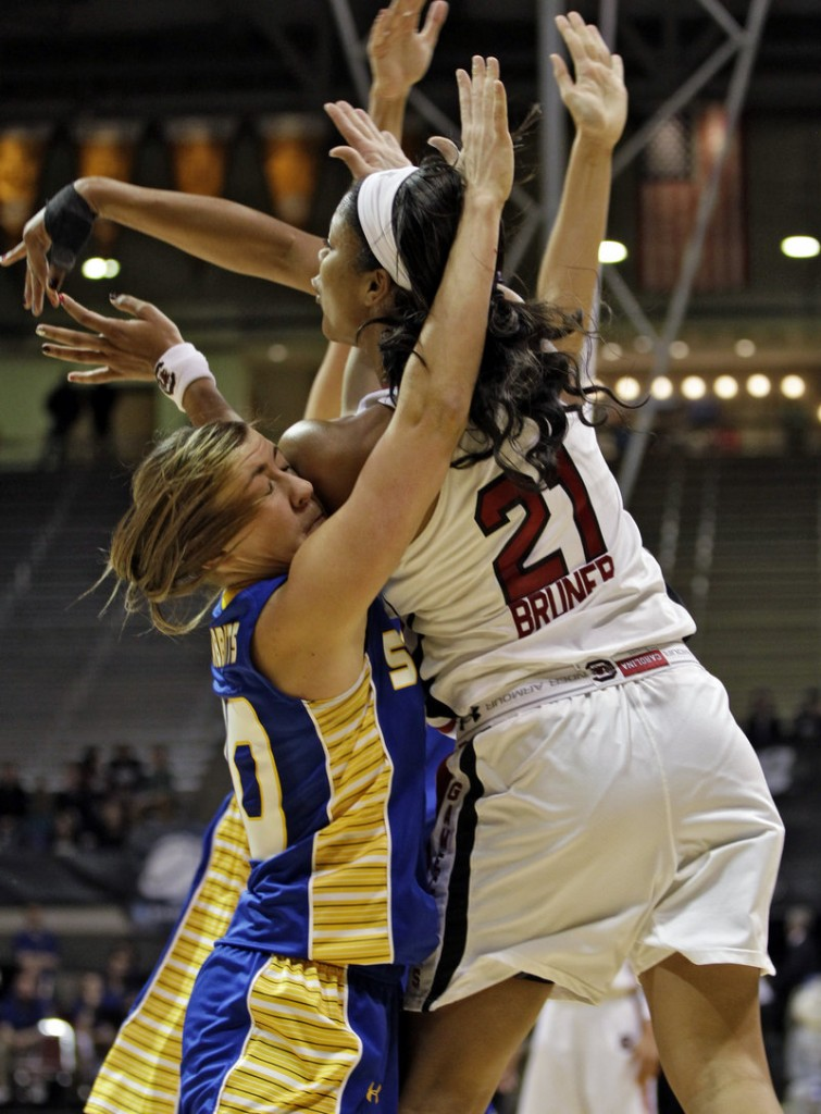 South Dakota State's Ashley Eide gets a shoulder to the face while trying to stop a pass by South Carolina's Ashley Bruner (21) during Saturday's game in Boulder, Colo.