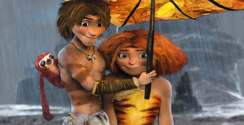 """Belt the sloth, from left, voiced by Chris Sanders; Guy, voiced by Ryan Reynolds; and Eep, voiced by Emma Stone, are shown in a scene from """"The Croods."""""""