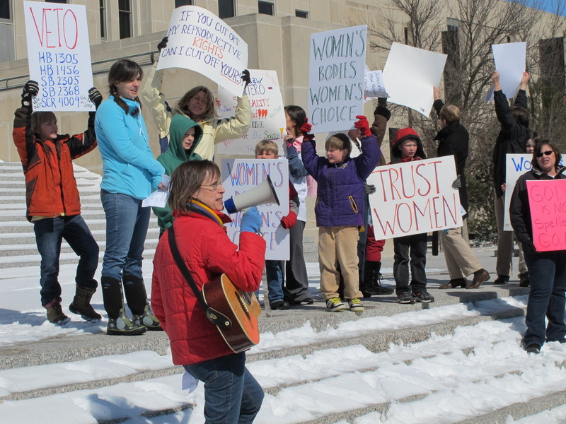 Kris Kitko leads chants of protest at an abortion-rights rally at the state Capitol in Bismarck, N.D., on Monday. Demonstrators were protesting a package of measures that would give the state the toughest abortion restrictions in the nation.