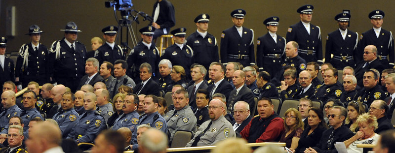 Law enforcement and corrections officers attend a memorial service for Tom Clements, the chief executive of the Department of Corrections, at New Life Church in Colorado Springs, Colo., on Monday. Clements was shot and killed on the doorstep of his home last week in Monument, Colo.