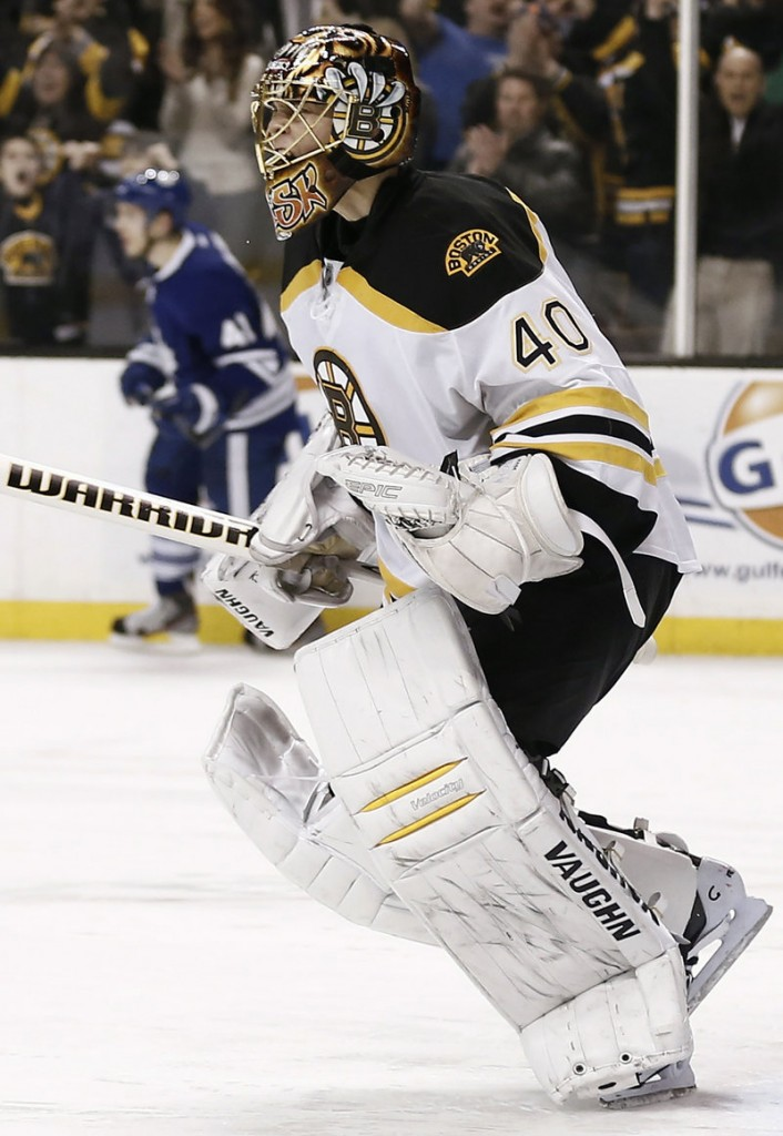 Boston goalie Tuukka Rask celebrates after turning aside Toronto's Nikolai Kulemin's shootout bid to seal the Bruins' victory Monday night.