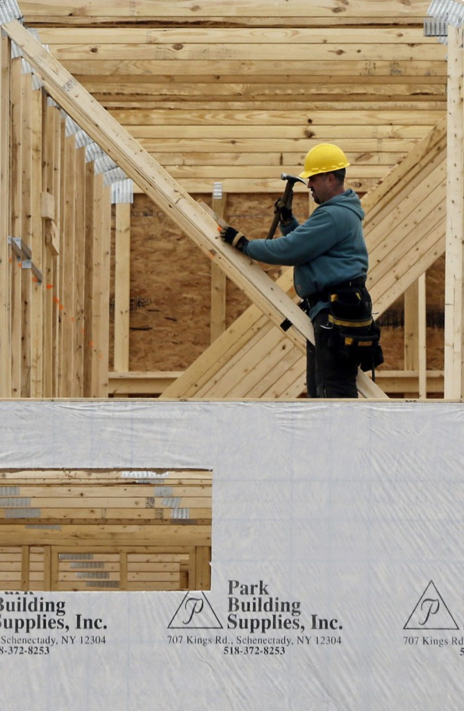 A new townhouse is under construction in Colonie, N.Y. Sales of new homes fell in February after climbing to the highest level in more than four years in January. They are up 12.3 percent from a year ago.