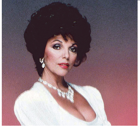 "Joan Collins of ""Dynasty"" fame models shoulder pads."