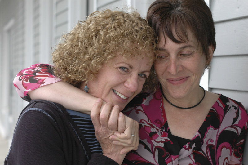 Photo by Beth Kucucha: Sazanne Blackburn, left, and Joanie Kunian embrace on a recent trip to Massachusetts.
