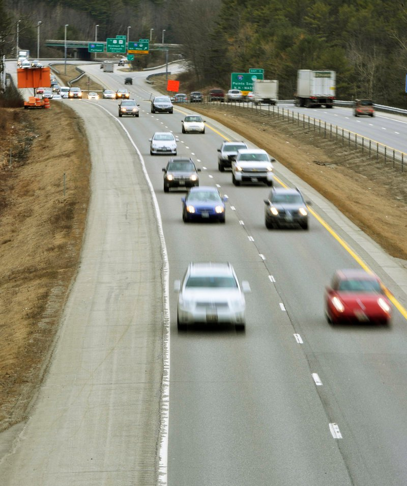 Traffic flows along Interstate 295 near the Falmouth exit on Wednesday March 27, 2013. A bill now before the Legislature would allow Maine's transportation commissioner to raise the speed limit to 75 mph on I-195 and Interstate 95.