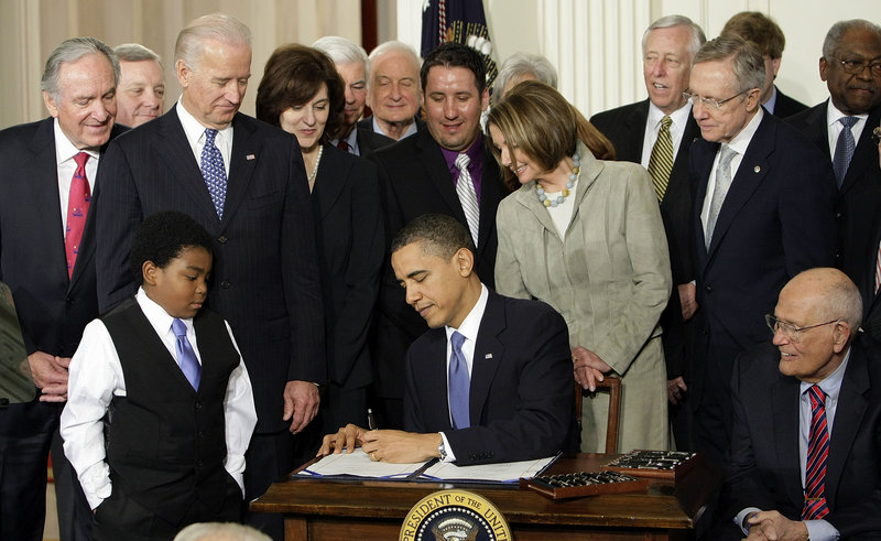President Barack Obama signs the health care bill into law in 2010. Medical claims costs, the biggest driver of health insurance premiums, will jump about 32 percent for individual policies under the Affordable Care Act, a study concludes.