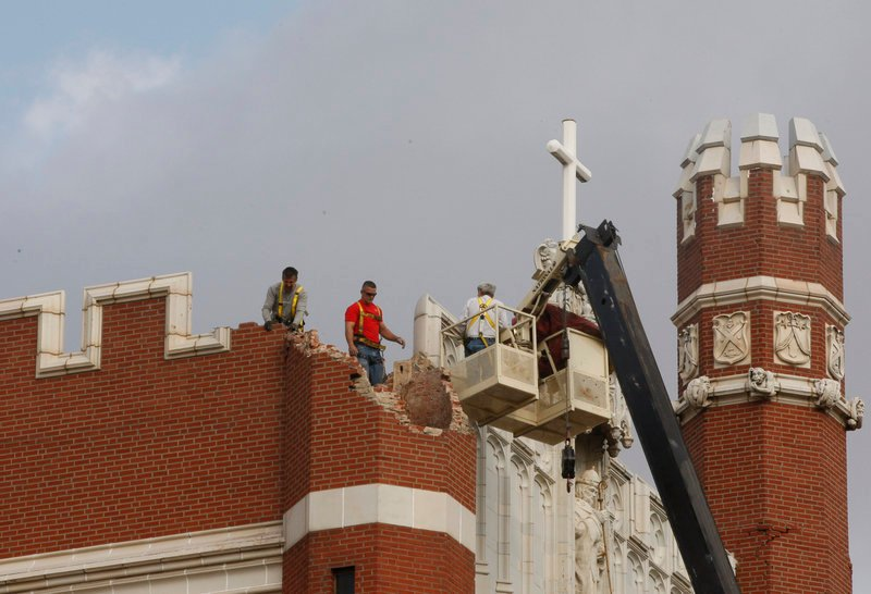 Workers inspect damage in Shawnee, Okla., on Nov. 6, 2011. A team of scientists has determined the quake was caused when oil drilling waste was injected deep underground.