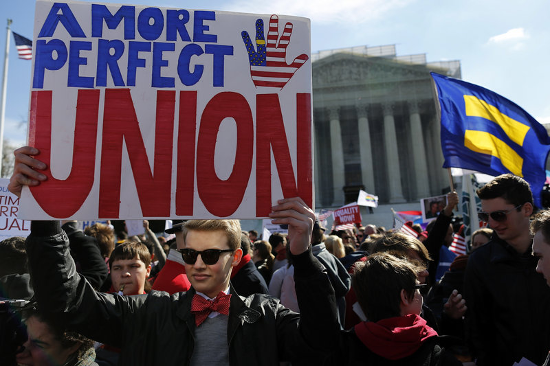 Protesters rally against the Defense of Marriage Act in front of the U.S. Supreme Court in Washington on Wednesday. Congress overwhelmingly supported the law in 1996.